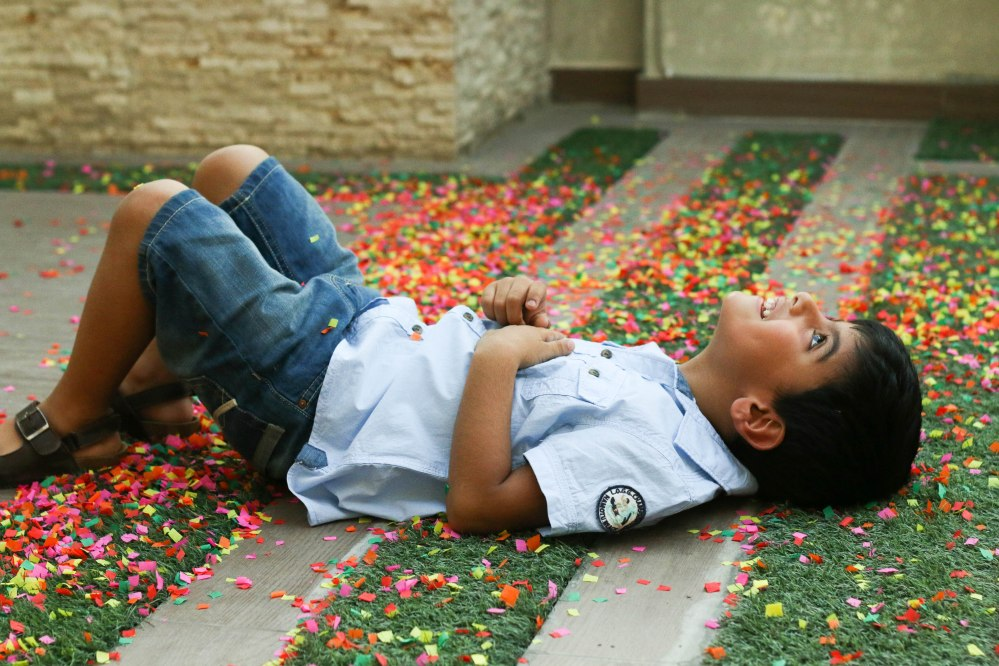 boy playing with confetti