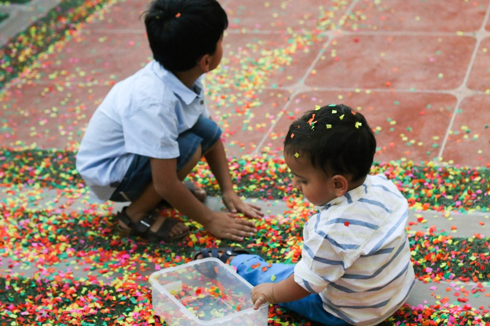 little boys playing with confetti