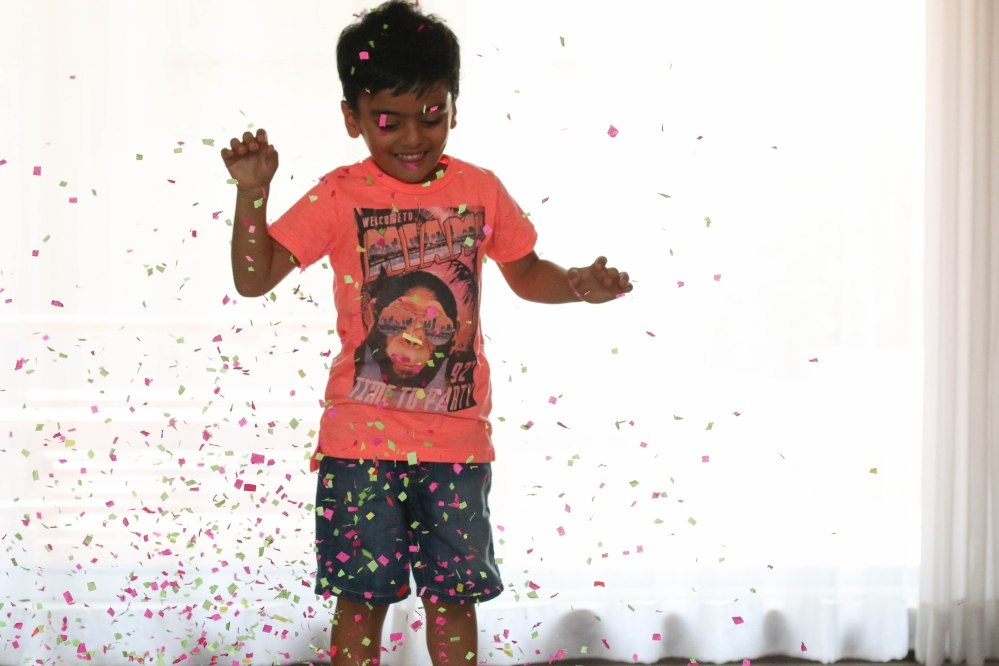 kids jumping in confetti