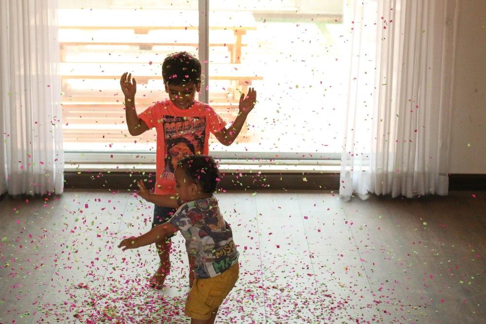 kids in confetti rain