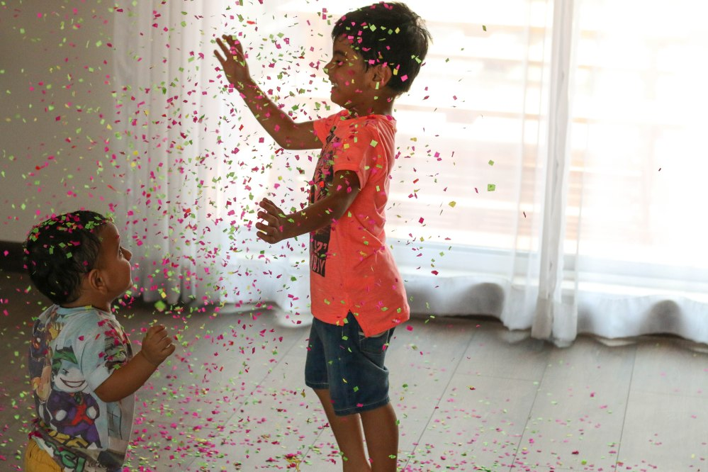 kids jumping in confetti rain