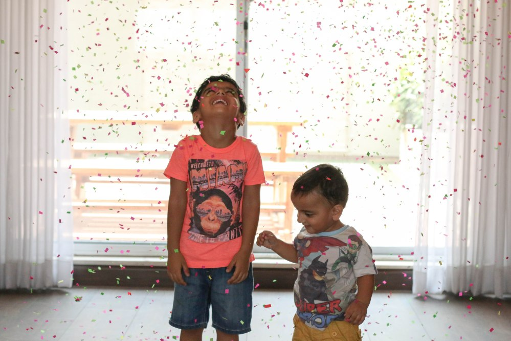 kids in confetti snow